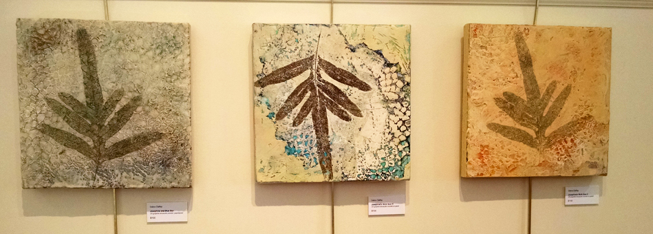 """My work: """"Josephine's Work Now II"""", """"Josephine's Work Now III"""", and """"Josephine and Blue Star"""", encaustic, crocheted doily, pigment stick, 12 x 12 inches"""