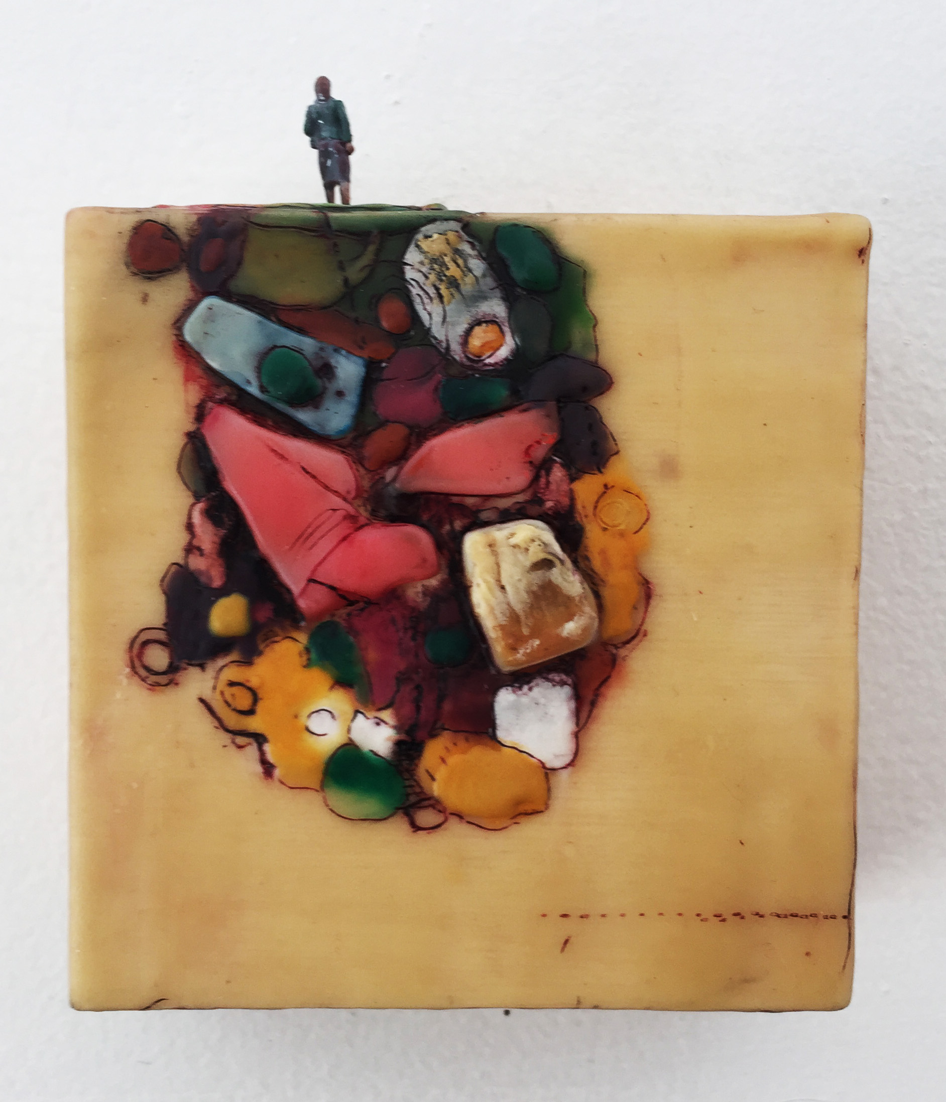 Hélène Farrar, What We Carry: Work Day, encaustic and painted small person model,4 x 4 inches