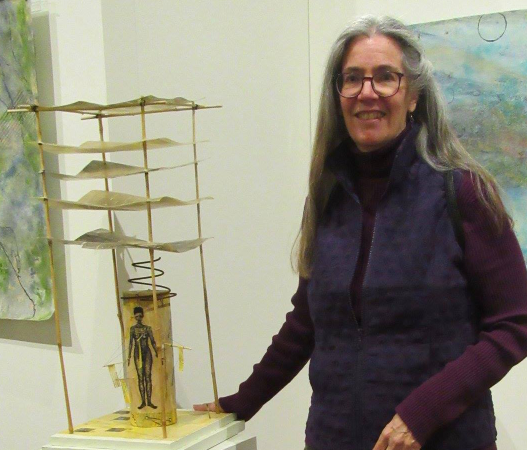 Soosen Dunholter, with her work, A Constellation of Symptoms, at the Saco Museum